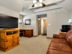 Optional Studio Suite, full size office desk, satellite TV & leather queen size hide-a-bed couch