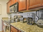 The kitchen is fully equipped with stainless steel appliances to assist in five-star feasts.
