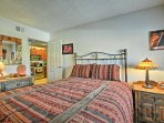 The bedroom features a plush queen-sized bed.