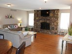 Comfortable and tastefully decorated main family area with fire place (not operational)