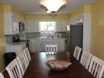 Updated and fully stocked kitchen with seating for 10, don't forget the lake view!!!!