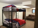 Downstairs bunk room with 2 fulls beds, 2 couches, TV and game area.  Lake views as well!!!