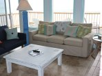 Living room.  Tan couch converts to a standard sized bed.  Navy couch converts to  a twin bed