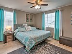 The bright and breezy master bedroom boasts  king bed!