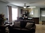 Dining/Living Room There is a Sofa Sleeper, Free WiFi and Cable TV. Large Screen In Patio with Grill