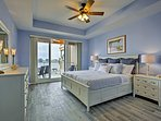 The master bedroom boasts a king bed and panoramic views.