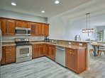 With granite countertops and stainless steel appliances, the kitchen feels like a Food Network Studio.