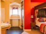 This is a fine bedroom with a lovely four poster double bed and feature bath