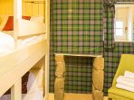 Check out the tartan walls in the bunk room