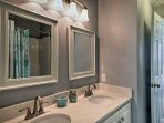 This Jack-and-Jill style bathroom is shared between the second and third bedrooms.
