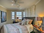 Get in the travel spirit when you stay in the second bedroom, decorated with eclectic accent pieces.