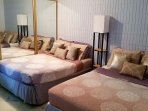 Downstairs bed with 2  new queen and full sized beds, closet and