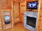 TV and fireplace in bunk room