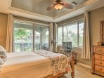 This king master suite provides a flat-screen cable TV and access to the front porch.