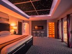 See-to-believe master bedroom with starlight ceiling and ultra-modern amenities