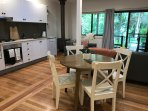 Open floor plan living, dining and kitchen allow you to enjoy the garden view.