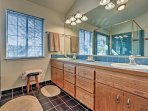 The en-suite master bath is spacious, with plenty of counter space.