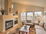 The gas fireplace serves both the dining and living room.
