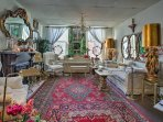 Unwind in the eclectic living room and play some tunes on the piano.