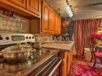 The kitchen has a flat-top stove, side-by-side fridge, and more!