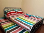 Aircon room.queen size bed with different bed sheet
