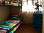 Fan room. Bunk bed with pull out bed. Fan. Cabinet