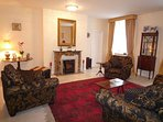 Relax in the sitting room to talk over your day exploring and plan for the next