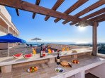 Outdoor servery and food preparation area  looks out over the ocean