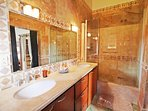 En suite master vanity with a double vanity and shower