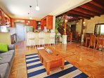 The open plan living area downstairs also has is a large wooden dining table with seating for six
