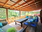 An amazing spacious covered verandah with large comfy couches