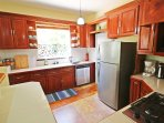 The fully stocked kitchen has all you'll need while on vacation, including a dishwasher, stove and oven, microwave...