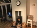 Working wood burner in the kitchen opening to  dining area