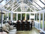 Conservatory with a dining table