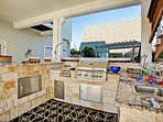 outdoor kitchen with full size gas grill and space to hang out.