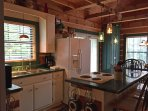 Fully appointed kitchen with counter seating, perfect for gathering