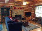 Living room with gas fireplace and DISH TV
