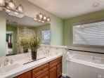 Luxurious master ensuite bath with a large soaking tub, Shower, with heated tiles. walk-in closet.