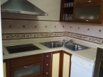 Kitchen with all appliances and ample storage. Filtered drinking water