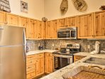 The fully equipped kitchen is highlighted by stainless steel appliances and granite countertops.
