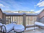 Breathe in the fresh alpine air on your private deck overlooking the mountains and community pool.
