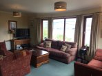 The lounge with views across Loch Broom and into the mountains beyond