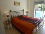 Double room with kingsize bed with fitted wardrobes and en-suite and door to balcony