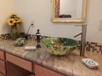 The 'fish' in the casita's vessel sink looks so real you'll think it will jump up to wink at you!
