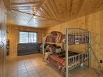 The third bedroom features a full-over-full bunk bed.