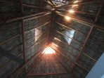Mayan traditional, stylish palapa roof maintains house cooler.