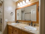 Remodeled guest bathroom with granite counter tops and bamboo cabinets.