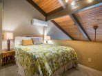Queen size bed in upstairs loft