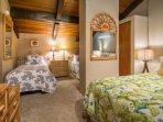 Upstairs loft bedroom area, sleeps 4 and includes split AC unit