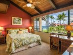 Large master bedroom with king sized bed, ocean view and split AC unit